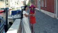 Happy bride showing ring to her bridesmaid in Venice, crane shot HD Stock Footage