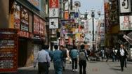 Stock Video Footage of Dotonbori Busy Shopping Street Osaka City Center People Passing Shoppers Walking