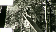 LITTLE GIRLS Fun on Slide PLAYGROUND 1960s (Vintage Film Home Movie) 5440 Stock Footage