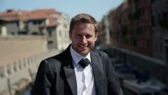 Portrait of young happy groom in Venice, crane shot HD Stock Footage