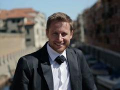 Portrait of young happy groom in Venice, crane shot NTSC Stock Footage