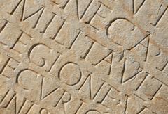 roman writing as background - stock photo
