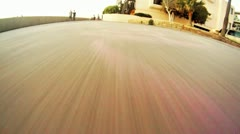 POV SKATEBOARDING ON THE STRAND Stock Footage
