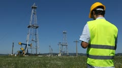 HD Engineer control at Fossil Fuel Energy, Oil Pump, Pumpjack, Old Pumping Unit Stock Footage