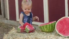 Toddler takes watermelon slice Stock Footage