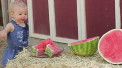 Toddler watermelon play Stock Footage