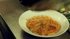 Pour pasta  in to a dish Stock Footage