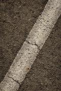 Diagonal stripe in asphalt Stock Photos