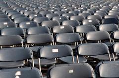 plastic stadium chairs - stock photo