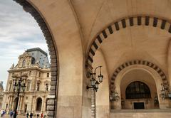 gate in the louvre. - stock photo