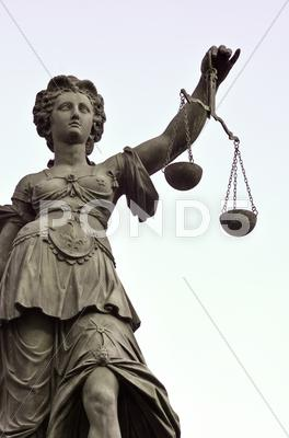 Stock photo of statue of lady justice in frankfurt germany