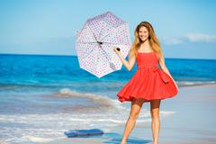 beautiful woman walking on tropical beach - stock photo