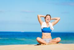beautiful woman relaxing on the beach in hawaii - stock photo