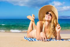 beautiful woman relaxing on tropical beach - stock photo