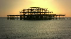 West Pier in Brighton, UK, at sunset - stock footage