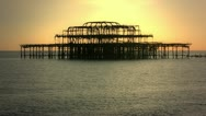 West Pier in Brighton, UK, at sunset Stock Footage