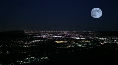 Super cool moon shot with blackout of Denver, car lights in foreground Stock Footage