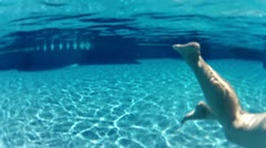 Feet swim under the water Stock Footage