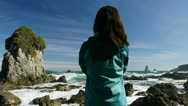 Stock Video Footage of Woman looks out over rough ocean