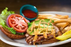 Avocado chicken burger Stock Photos