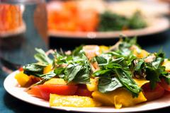 green salad with mango and tomatoes - stock photo