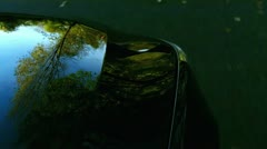 Black car on the country road - focus on motor hood Stock Footage