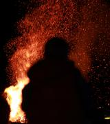 Silhouette Figure Standing In Front of Bonfire Stock Photos