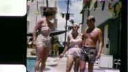 Stock Video Footage of FRIENDS GOOF OFF Motel Pool 1960 (Vintage Old Film Home Movie)