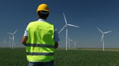 Stock Video Footage of Engineer is Checking, Wind Power Turbines, Energy Production, Windmills, Eco