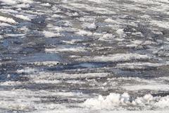 Ice and Snow Slush Road Hazards - stock photo