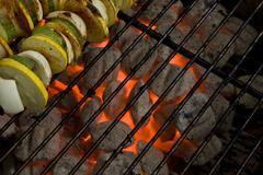Hot Charcoal Grill Coals & Vegetable Skewers Stock Photos