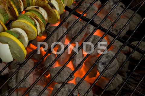 Stock photo of Hot Charcoal Grill Coals & Vegetable Skewers