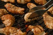 Stock Photo of Grilled Chicken Tenders On A Charcoal Grill