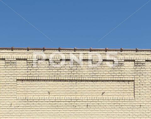 Stock photo of Brick facade roofline of an old downtown store