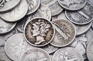 Stock Photo of Pile of old USA Silver Dimes & Quarters