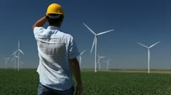 Engineer is Checking, Wind Power, Turbine, Energy Production, Renewable Mill - stock footage
