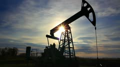 Working oil pump at sunset Stock Footage