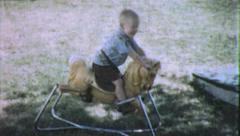 Little Boy RIDES ROCKING Horse Play 1970 (Vintage Film 8mm Home Movie) 5502 Stock Footage