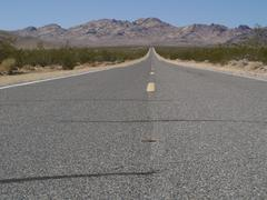 endless road at the desert - stock photo