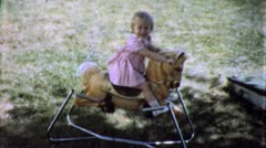 Little Girl RIDES ROCKING Horse Play 1970 (Vintage Film 8mm Home Movie) 5503 Stock Footage