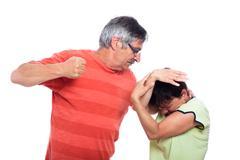 Aggressive man and unhappy woman Stock Photos