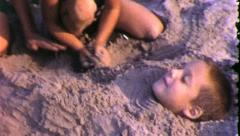 MOM BURIES Son in Sand Beach Family Vacation 1960s Vintage Film Home Movie 5514 Stock Footage