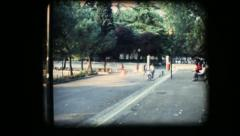 Vintage 8mm. Sunny park with children playing Stock Footage