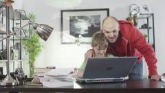 Father and son browsing the internet  - stock footage