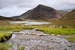 landscape over llyn idwal towards pen-yr-ole-wen in snowdonia national park - stock photo