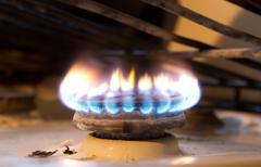 Fire on a gas cooker Stock Photos
