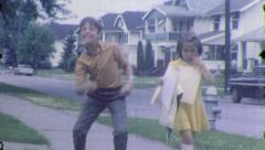 SUBURBAN KIDS Walking Home Brother Sister 1960s Vintage Film Home Movie 5525 - stock footage