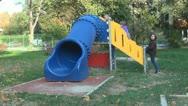 Children Playing at Playground, Children Sliding on a Slide Stock Footage