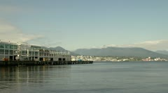 Sea Bus moving away by Canada Place, Vancouver Stock Footage