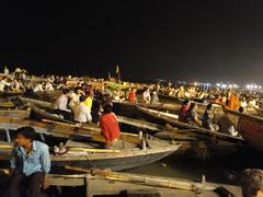 Boatloads of tourists and hindu pilgrims attend aarti evening services Stock Photos